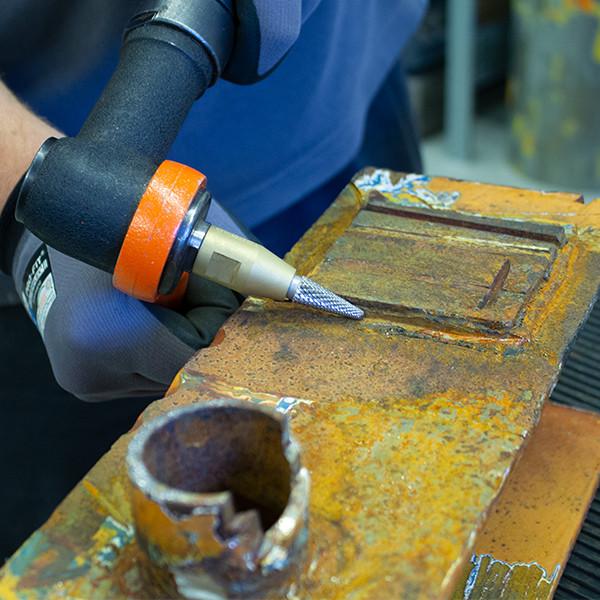 Welded plate grinding