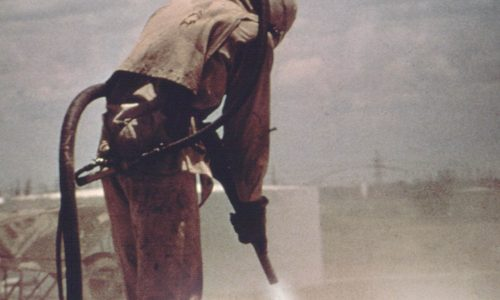Sandblasting with protective gear